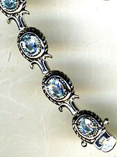 "925 Sterling Silver Blue Topaz Oval 12 Stone Bracelet  Length 7.1/2""  16 grams"