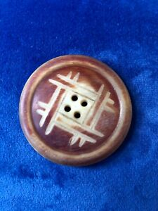 """Old horn button. Carved, four-hole. 1 9/16"""" round."""