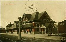 Railroad Depot: Muncie, IN. Pre-1910. Men, Bicycle, Train Station.