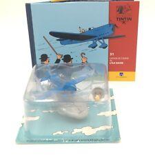 En Avion Tintin l'avion de course de l'ile noire N31 livret coque plastic