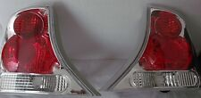 00-05 FORD FOCUS SEDAN/4DR/SET OF TWO/RG&LF/ TAIL LAMPS/ CHROME & CLEAR LENS.