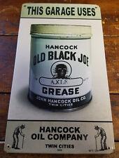 THIS GARAGE USES HANCOCK OLD BLACK JOE AXLE GREASE HEAVY METAL ADVERTISING SIGN