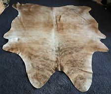 SHADES OF LIGHT TAN AND BEAUTIFUL EXOTIC MARKINGS - A BRAZILIAN COWHIDE RUG