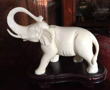 "a vintage white elephant on a wooden plinth. ivorene? 7.5"" x 8"""