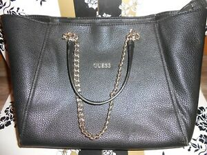 GUESS BAG IN BLACK LEATHER USED AS SCHOOL BAG HANDLE SLIGHTLY DAMAGED 40CMX28CM