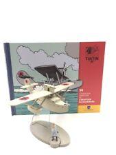 En Avion Tintin l'avion l'hydravion américain l'éruption karamako  N38 livret