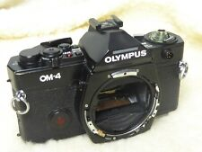 genuine olympus OM4 spare part. see pictures inc winder prism . not jammed body