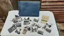 vintage photo album with photos plus extra photos in wallet