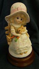 Vintage Price Products Rotating Music Box Porcelain Figurine Girl feeding Rabbit