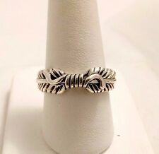 NATIVE AMERICAN R. KELLY STERLING SILVER FEATHERS RING. SIZE 8.5
