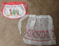 2 Vintage Christmas Aprons Sheer Flocked and Holly Hobbie