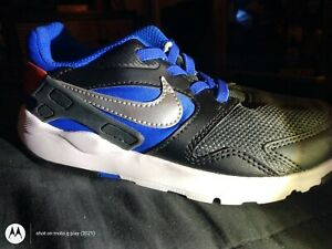 NIKE....NEW..NEVER WORN...SIZE 12C
