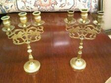 Lot of 2 Brass Lion Judiac Candleabra's