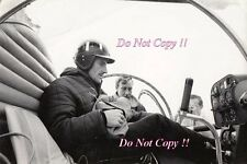 Graham Hill Portait sitting in a helicopter with his race helmet on Photograph