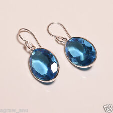 Swiss blue topaz faceted stone oval shaped elegant earring pair