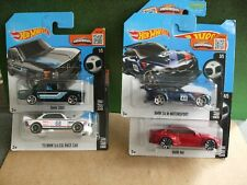 HOT WHEELS 4 ASSORTED BMW SPORTS CARS ALL MINT AND SEALED
