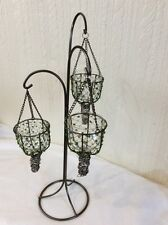A 3 ARM METAL STAND WITH CLEAR GLASS HOLDERS THAT SIT IN A BASKET / GREEN JEWELS