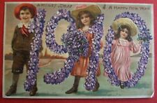 EMBOSSED Postcard POSTED 1910 A HAPPY NEW YEAR EMBOSSED 1910 IN FLOWERS