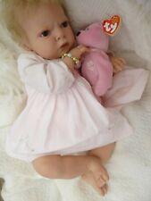 Beautiful Sabrina a little reborn baby girl from a Reva Schick sculpt