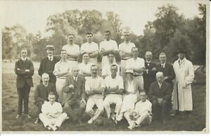CRICKET, UNKNOWN LOCAL SIDE WITH UMPIRE AND COMMITTEE MEMBERS, PHOTO POSTCARD
