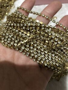 1 Meter clear crystal rhinestone encased in Cooper Gold metal chain trim 2.8mm