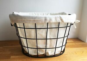 Sturdy metal storage basket with folding handles and linen liner
