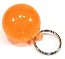 Schlüsselanhänger Kugel orange fluoreszierend leuchtet bei Schwarzlicht oranje