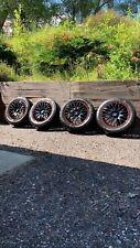 "Black/Red Alloys 15""x6J Calibre Motion 2"