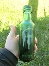 More details for antique dark green glass bottle by batey k.b. of london england.
