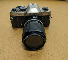 Nikon FM10 35mm SLR Film Camera with Nikon Nikkor zoom 43-86mm lens