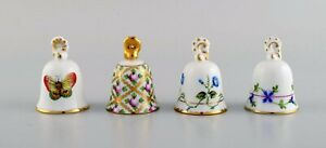 Four Herend table bells in hand-painted porcelain with flowers.