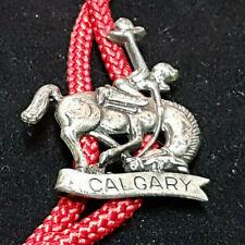 """Bolo Tie """"Calgary"""" Stampede? Cowboy & Bronco. Silver Color with Red Cord."""