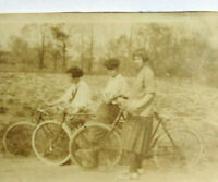 Very old vintage sepia small photo 3 women on bicycles!