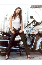 JENNIFER LOVE HEWITT - STANDING IN FRONT OF A MOTORCYCLE IN JEANS AND A TANK TOP