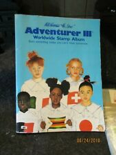 H.E. Harris Adventurer Worldwide Stamp Album with stamps & Hinges over 400 stamp