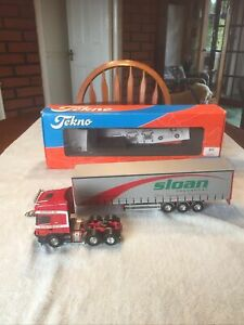 Tekno Scania 530 Topline Sloan Transport With Tri Axle Curtainsider Trailer