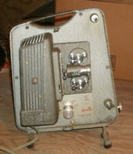 Vintage Keystone projector and a projection Leeders screen by Radient.