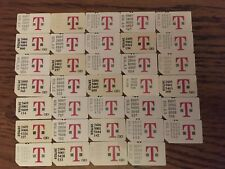 """34 Used Sim cards for T-Mobile with phone showing message saying """"Sim Required�"""
