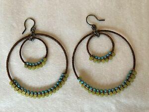Anthropologie large circular beaded hoop earrings turquoise yellow wrapped boho
