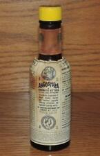 "VINTAGE 6.25"" ANGOSTURA AROMATIC BITTERS 1/2 FULL 4oz AMBER BOTTLE w/PAPER LABEL"