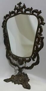 A vintage , metal , antique type table mirror