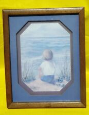 Vintage Wood-Framed Picture of a boy looking out over the ocean Home Interiors