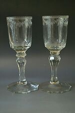 A PAIR OF GEORGIAN DRINKING GLASSES WITH FACED STEMS AND ENGRAVED BOWLS