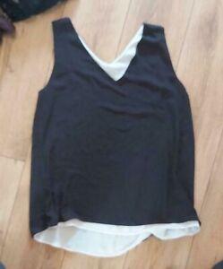 Ladies 'PEACOCKS' Black/White sleeveless lined Top. Size 16. vgc.
