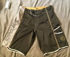 Speedo Embroidered Brown Tan Board Shorts. 32.   Embroidery. One Eyelet Missing