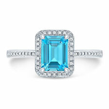 14k White Gold Emerald-cut Blue Topaz and Diamond Ring