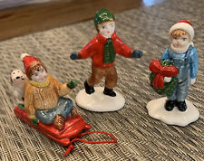 Dept 56 snow village Christmas Boy With Child On Sled W/ Dog & Girl With Wreath