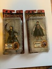 LORD OF THE RINGS ACTION FIGURES. LOT Of 2 King If Helms Deep Aragorn , Frodo