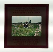 1950's Kodak Kodachrome 35mm Film Slide Man Sitting in Field Prairie Flowers