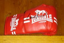 A boxing glove genuine signed by ex boxer Lennox Lewis